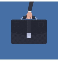 Hand holding a briefcase over blue background vector image vector image