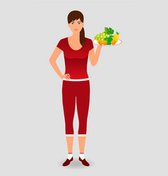 Healthy sportswoman holding a fruit tray healthy vector