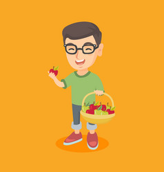Little caucasian boy holding basket with apples vector