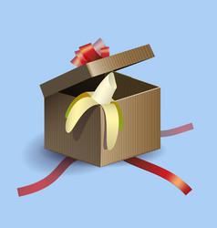 opened gift box with red strips and banana inside vector image
