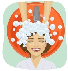 Hair washing at hairdressing salon young girl vector