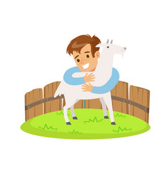 happy little boy embracing a white goat in a mini vector image