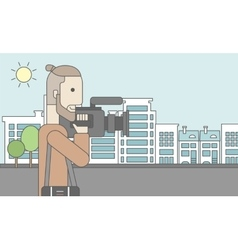 Cameraman with video camera vector