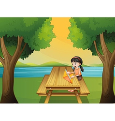 A girl making a kite at the table vector