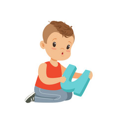 Flat character of preschool boy sitting on the vector