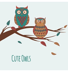 Two cute colorful owls sitting on a branc vector