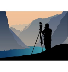 Photographer shooting at sunset vector