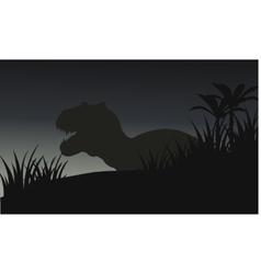 Silhouette of big tyranosaurus with grass vector