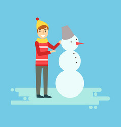 Smiling boy making a snowman winter activity vector