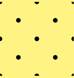 Tile pattern with black polka dots on yellow vector