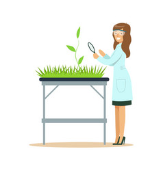 Woman biologist looking at green plant through vector