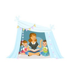 Mum reading a book to her children while sitting a vector
