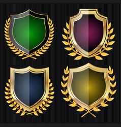 Golden shield set with laurel wreath vector