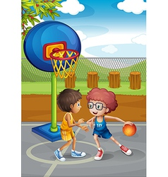 Two boys playing basketball at the basketball vector