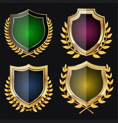 Golden shield set with laurel wreath vector