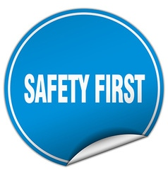 safety first round blue sticker isolated on white vector image