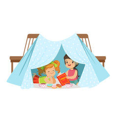 Cute little girls sitting and reading a book in a vector