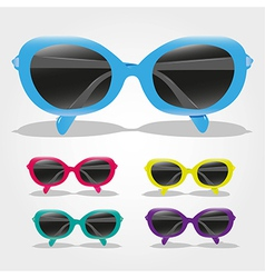 Set of colored sunglasses isolated on gray backgro vector