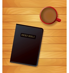 Holy bible and coffee on wood vector