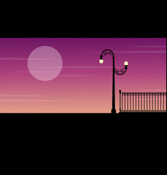 Silhouette of fence with street lamp scenery vector