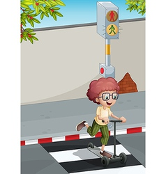 A boy with a scooter crossing the pedestrian lane vector