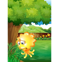 A sad yellow monster under the tree vector