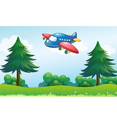 A toy plane flying above the hill vector image vector image