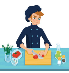 Happy young cook slicing tomato on chopping board vector