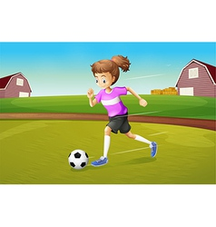 A girl playing football at the farm vector