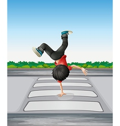 A boy breakdancing at the pedestrian lane vector