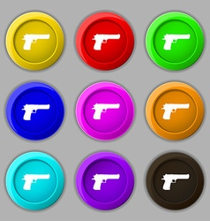 Gun icon sign symbol on nine round colourful vector