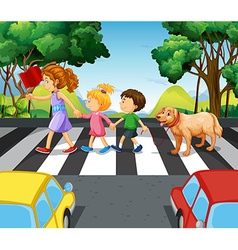 Children and dog crossing the road vector