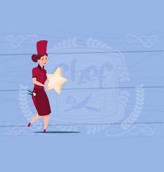 Female cook holding star best chef award happy vector