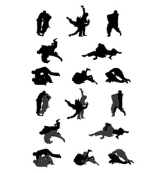 Jiu-jitsu and judo wrestlers silhouettes vector