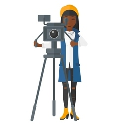 Camerawoman with movie camera vector