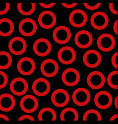 Seamless pattern with red rings vector
