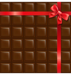 Chocolate with red bow vector