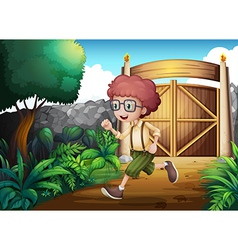 A young boy running inside the gate vector image