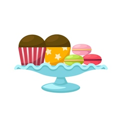 Macarons with cupcake in a glass cake stand vector