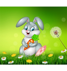 Little bunny holding carrot on grass background vector