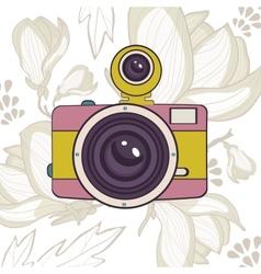 Elegant vintage camera on floral background vector