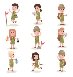 Set of boys and girls scouts with hiking equipment vector