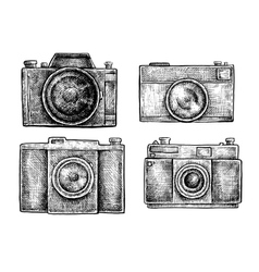 Set of ink hand drawn vintage cameras sketches vector