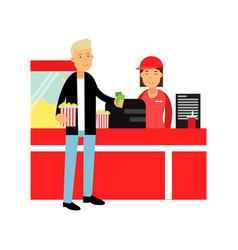 Young man buying popcorn in cinema theatre vector