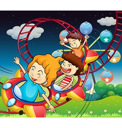 Three kids riding in a roller coaster vector image vector image