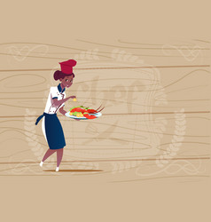 Female african american chef cook holding tray vector
