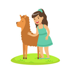 Girl standing on green grass and petting fluffy vector