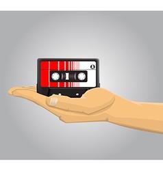 Hand holding an audio casette vector