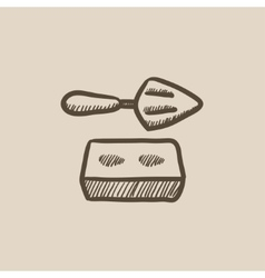 Spatula with brick sketch icon vector