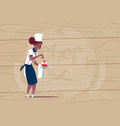 Female african american chef cook holding dessert vector